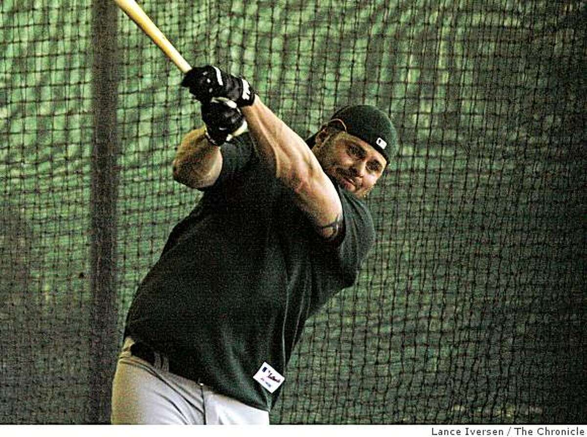 Oakland Athletics first baseman Jason Giambi takes batting practice in the cages at Papago Baseball Complex Thursday February 19, 2009 in Phoenix Arizona
