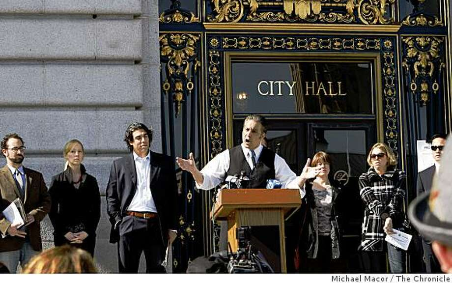 San Francisco Supervisor Ross Mirkarimi, (at podium) holds a press conference on the steps of City Hall to announce the proposed changes in the running of this year's Bay to Breakers foot race. Photo: Michael Macor, The Chronicle