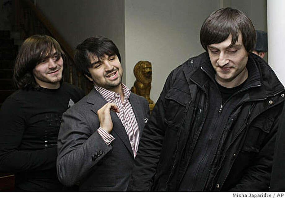 Chechen brothers Dzhabrail, left, and Ibragim Makhmudov, right, former defendants in the murder case of Russian investigative journalist Anna Politkovskaya, and defense lawyer Murad Musayev, center, leave a court in Moscow, Thursday, Feb. 19, 2009. A Moscow jury acquitted three men, ethnic Chechen brothers Dzhabrail and Ibragim Makhmudov and a former Moscow police officer, Sergei Khadzhikurbanov, on murder charges Thursday in the killing of investigative journalist and Kremlin critic Anna Politkovskaya. (AP Photo/Misha Japaridze) Photo: Misha Japaridze, AP