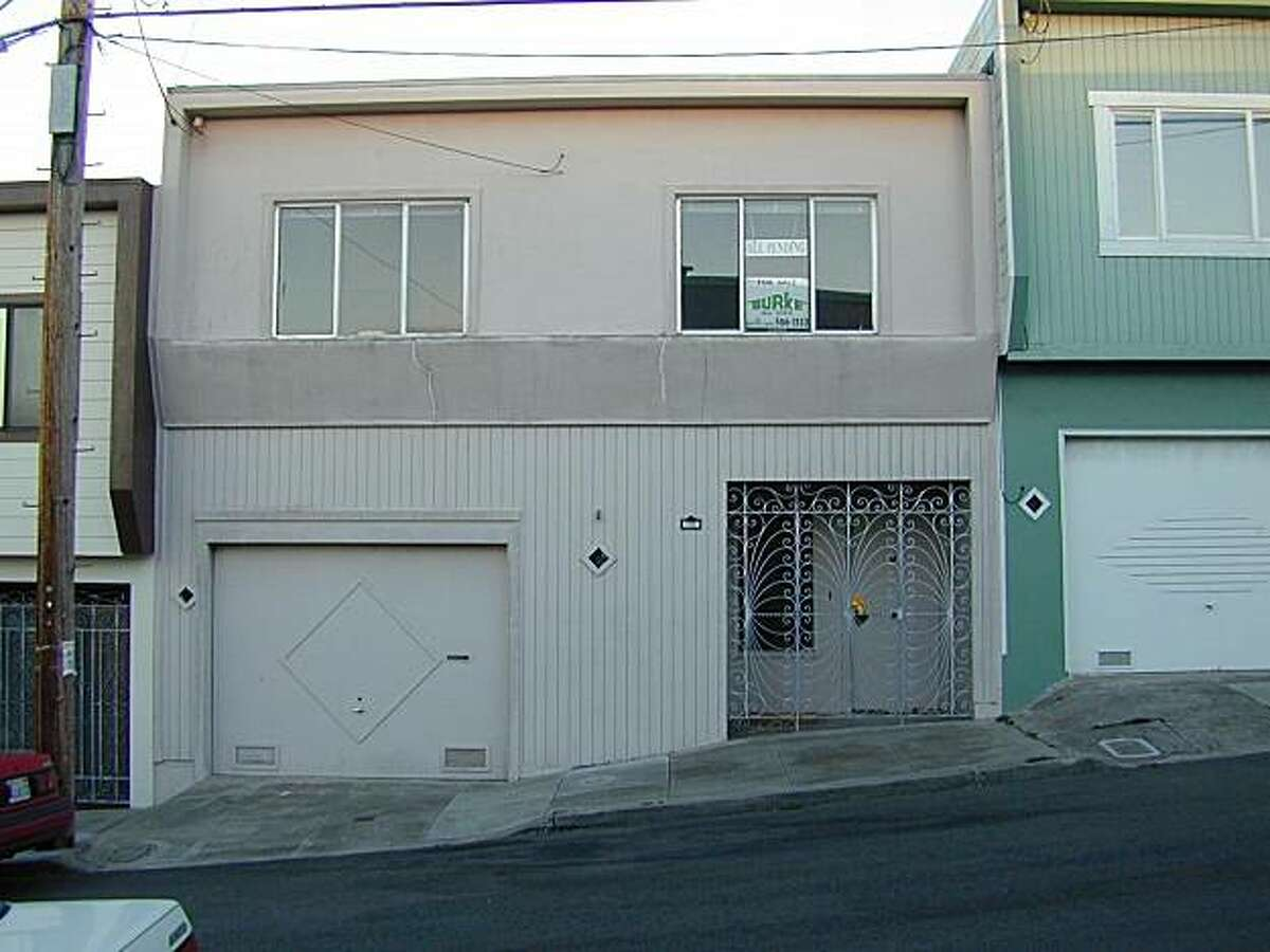 The home's exterior, before