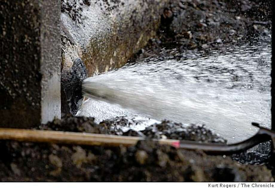 Waste water flows out of a leak in the pipeline at the Sausalito-Marin City Sanitary District Fort Baker treatment plant on Feb. 18, 2009 in Sausalito, Calif. Photo: Kurt Rogers, The Chronicle