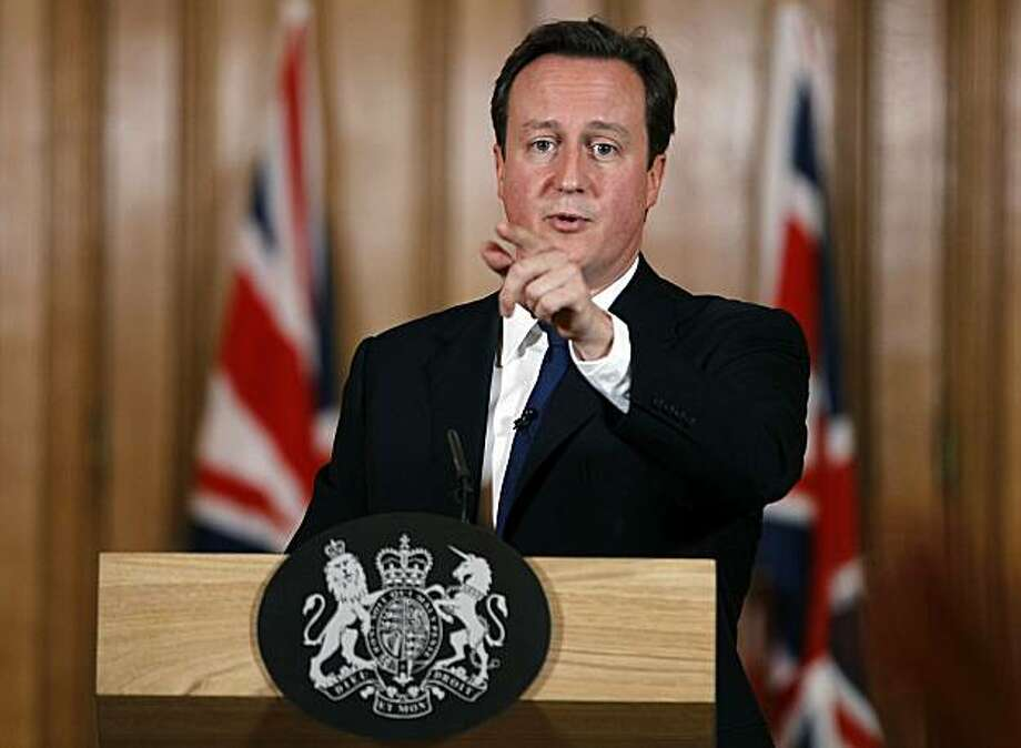 LONDON - OCTOBER 11:  Britain's Prime Minister David Cameron gestures during a press conference in Downing Street on October 11, 2010 in London, England. During the press conference the prime minister stated that British aid worker, Linda Norgrove may have been accidentally killed by a grenade detonated by a member of the U.S. rescue team rather than her Taliban captors. David Cameron said the rescue was being reviewed by the commander of Nato forces in Afghanistan, General David Petraeus. Photo: Pool, Getty Images
