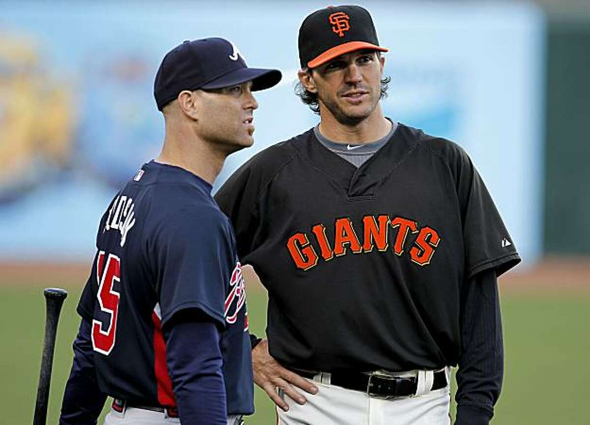 Former teammates, Tim Hudson, with the Braves and Barry Zito of the Giants, hang out during Atlanta's practice, as the San Francisco Giants and the Atlanta Braves take to the field at AT&T Park in San Francisco, Calif., for the final day of batting practice on Wednesday Oct. 6, 2010 before the start of the National League Division Series playoffs.