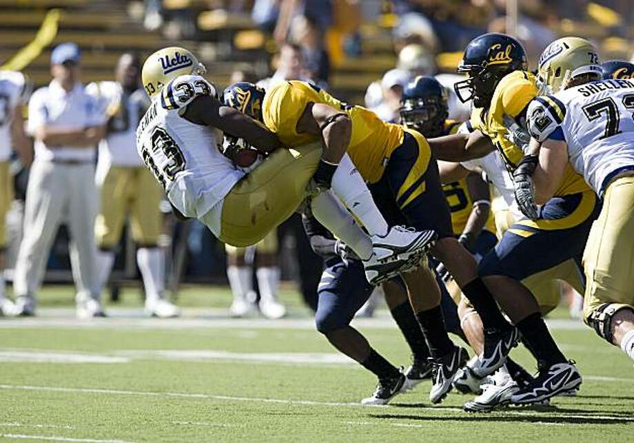 Cal linebacker Mychal Kendricks elevates UCLA running back Derrick Coleman before depositing him on the turf. Photo: Courtesy Of GoldenBearSports.com