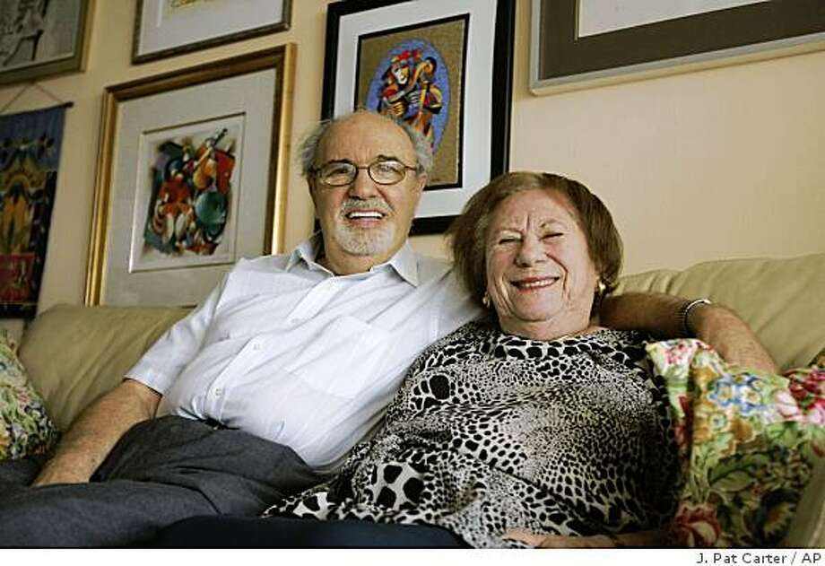 "In this Sept. 25, 2008 file photo, Herman and Roma Rosenblat pose for a photo in their North Miami Beach, Fla. home. Herman Rosenblat, who has acknowledged inventing his story of meeting his wife on opposite sides of a concentration camp fence, told ""Good Morning America"" that he has no regrets and would tell the story again given another chance. ""It wasn't a lie,"" he said during a taped segment aired Wednesday, Feb. 18, 2009. ""It was my imagination, and in my mind, I believed it. Even now, I believe it."" Photo: J. Pat Carter, AP"