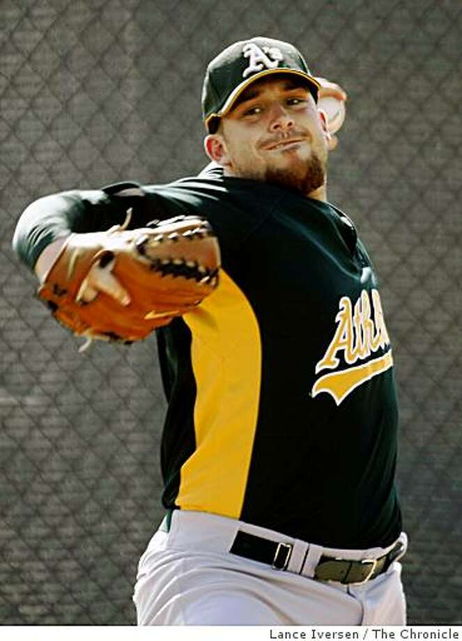 A's #25 left-handed pitcher Dana Eveland works in the bullpen. Pitchers and catchers warm up on the infield at Papago Park, home of the Oakland Athletics for spring training in Phoenix, Saturday morning.  By Lance Iversen/The San Francisco Chronicle Photo: Lance Iversen, The Chronicle