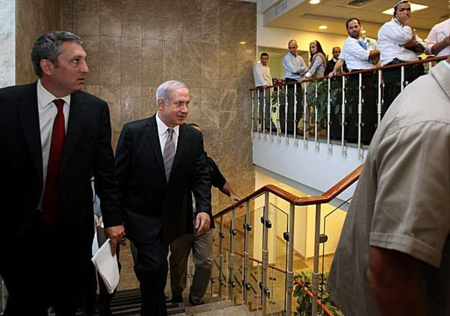 "Israeli Prime Minister Benjamin Netanyahu arrives at the weekly cabinet meeting at his Jerusalem office, Sunday, Oct. 10, 2010. Israel's Cabinet is set to approve a charged bill that will require new citizens to pledge allegiance to a ""Jewish and democratic"" state. Photo: Gali Tibbon, AP"