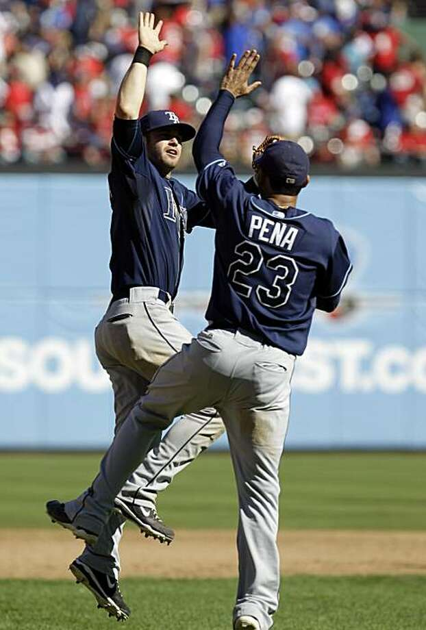 Tampa Bay Rays' Evan Longoria, left, and Carlos Pena celebrate after the Rays defeated the Texas Rangers 5-2 in Game 4 of baseball's American League Division Series on Sunday, Oct. 10, 2010, in Arlington, Texas. Photo: David J. Phillip, AP