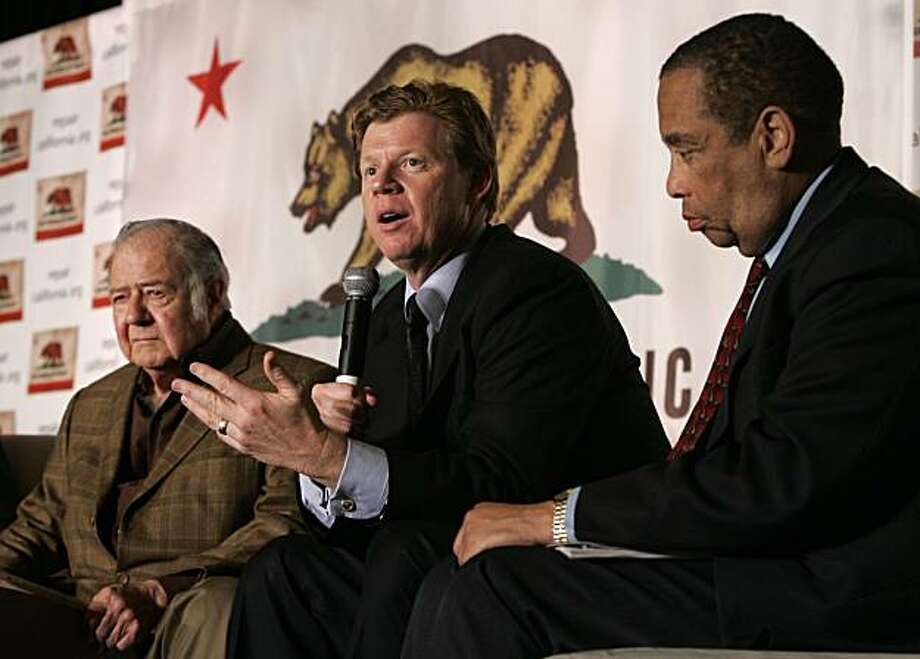 Former state Assemblyman Guy Houston, R-Pleasanton, center, flanked by former Assemblyman William Bagley, R-Marin, left, and Elihu Harris, D-Oakland, discusses ways to reform state government during a summit in Sacramento, Calif., Tuesday, Feb. 24, 2009. Delegates at the California Constitutional Convention Summit debated whether the state Constitution should be completely rewritten. (AP Photo/Rich Pedroncelli) Photo: Rich Pedroncelli, AP