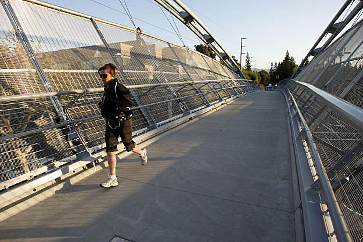 Erin Stampa jogs on the new pedestrian bridge over Treat Blvd. near Pleasant Hill BART station in Pleasant Hill, Calif. on Sept. 07, 2010.