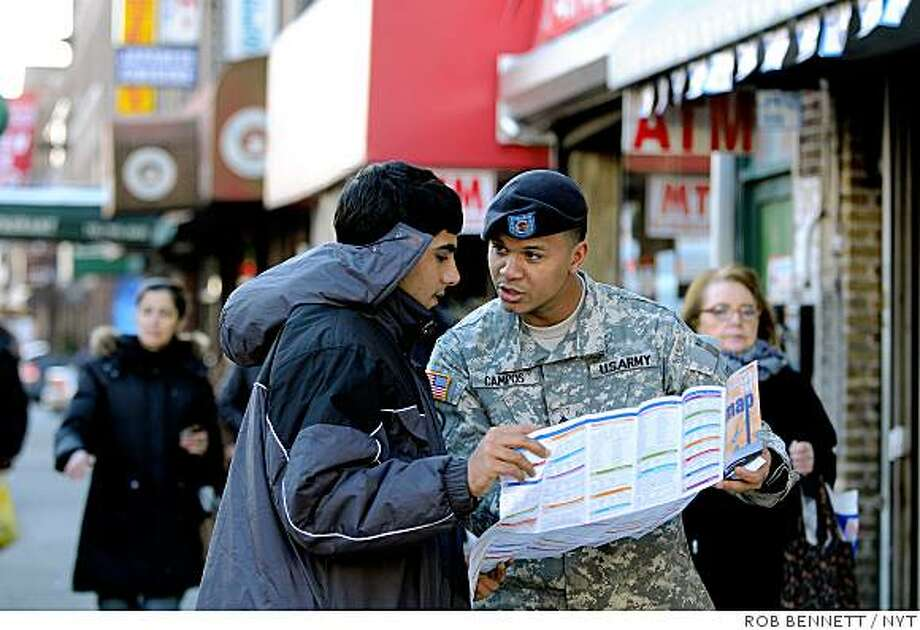 (NYT4) NEW YORK -- Feb. 14, 2009 -- MILITARY-IMMIG  -- Staff Sgt. Alejandro Campos, in Bay Ridge, Brooklyn, on Feb. 6, 2009. Campos became a citizen after joining the Army. (Rob Bennett/The New York Times) Photo: ROB BENNETT, NYT