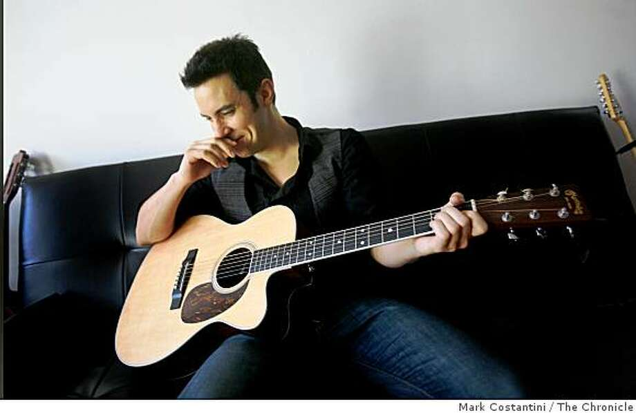 Eoin Harrington, an Irish singer-songwriter plays his guitar at his home in San Francisco, Calif.on Tuesday, February 10, 2009. Photo: Mark Costantini, The Chronicle