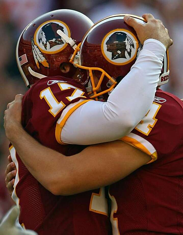 LANDOVER, MD - OCTOBER 10: Washington Redskins kicker Graham Gano #4 is hugged by punter Hunter Smith #17 after kicking the game winning kick in overtime against the Green Bay Packers at FedExField on October 10, 2010 in Landover, Maryland. The Redskins won the game 16-13. Photo: Win McNamee, Getty Images