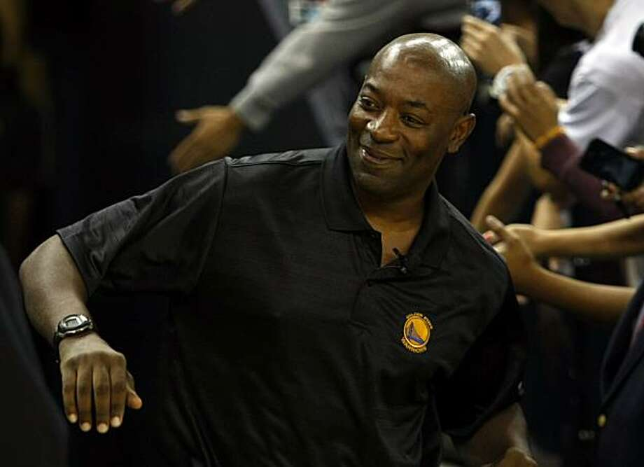 Head coach Keith Smart greats fans during an open practice at Oracle Arena Wednesday, October 6, 2010, Oakland, Calif.  As the new season is set to begin the Golden State Warriors introduce new players and a largely new coaching staff to their fans. Photo: Adm Golub, The Chronicle