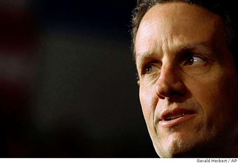 Treasury Secretary Timothy Geithner is seen in the audience prior to President Barack Obama's remarks about the home mortgage crisis, Wednesday, Feb. 18, 2009, at Dobson High School in Mesa, Ariz. (AP Photo/Gerald Herbert) Photo: Gerald Herbert, AP