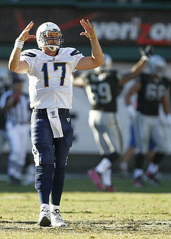 San Diego Chargers quarterback Philip Rivers (17) reacts after his fumble was returned by Oakland Raiders safety Tyvon Branch (33) for a 64-yard touchdown in the fourth quarter of an NFL football game in Oakland, Calif., Sunday, Oct. 10, 2010. The Raiderswon 35-27. Photo: Tony Avelar, AP