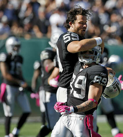 The Oakland Raiders teammate Jon Condo congratulates Nick Miller after he brings the ball to their 46 yard line in a runback in the third quarter against the San Diego Chargers at the Oakland-Alameda County Coliseum, Sunday Oct. 10, 2010, in Oakland, Calif. Photo: Lacy Atkins, The Chronicle