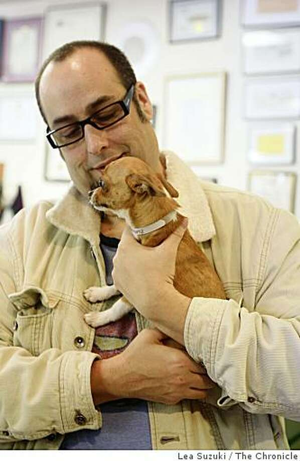 Carlos Soto of San Francisco holds Swipe, the Chihuahua puppy stolen from and then recovered by San Francisco Animal Care and Control this month, in San Francisco, Calif. on Tuesday, February 17, 2009. Soto won the lottery to adopt the puppy on  Tuesday, February 17, 2009. Photo: Lea Suzuki, The Chronicle