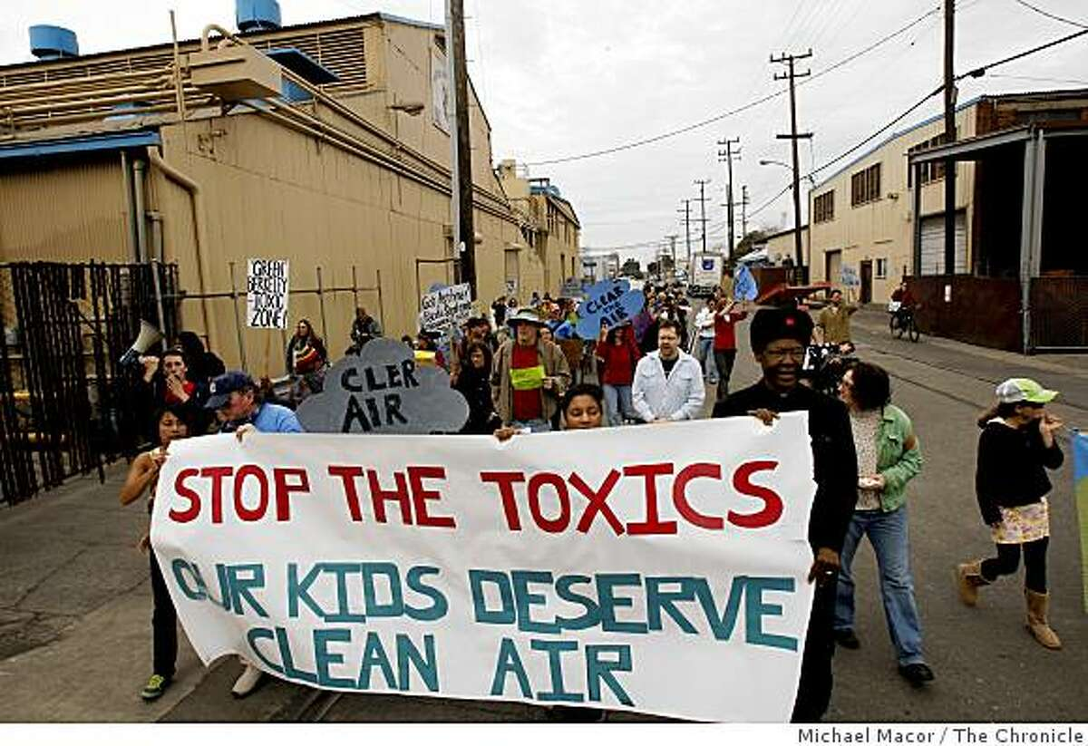 Berkeley residents and local environmentalist, make their way down Second St. in Berkeley, Calif., on Saturday Feb.21, 2009 in Berkeley, Calif., as they march past Pacific Steel Casting Co., a Berkeley firm they accuse of fouling the air and making life in the area unhealthy.