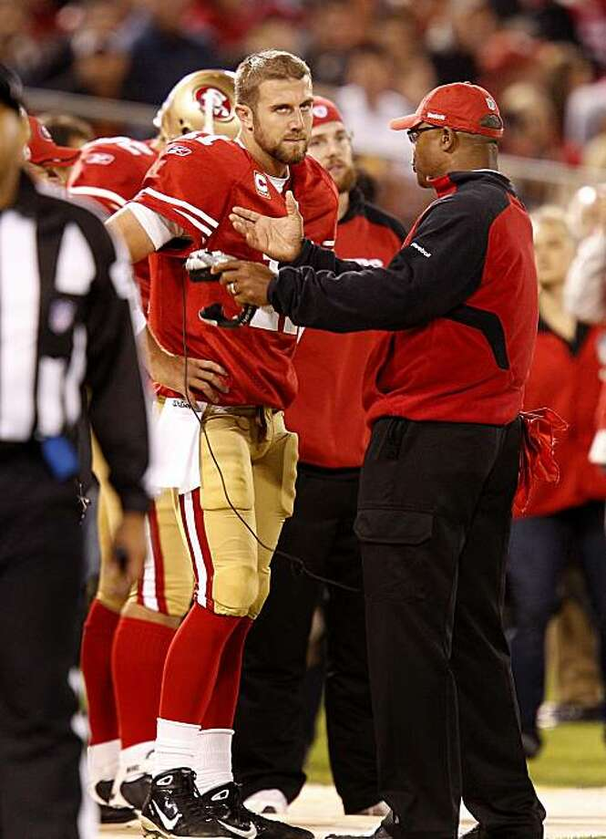 Alex Smith listens to coach Mike Singletary after his fumble in the fourth quarter. The San Francisco 49ers vs the Philadelphia Eagles Sunday October 10, 2010 at Candlestick Park in San Francisco, Calif. Photo: Brant Ward, The Chronicle