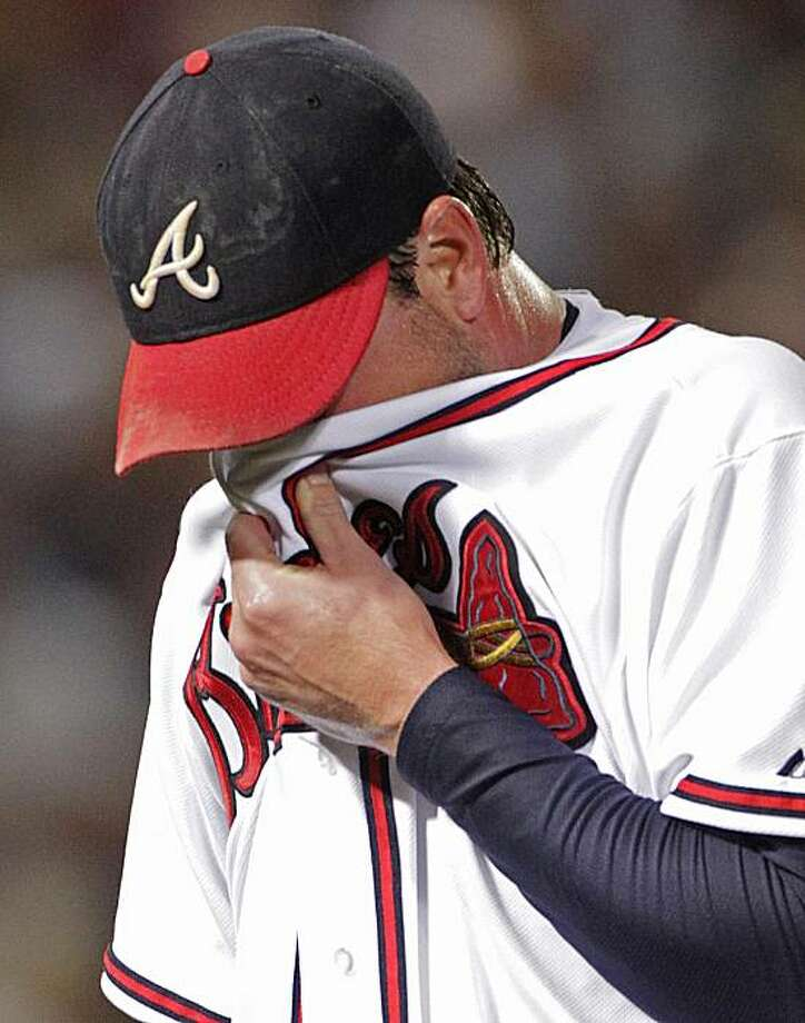 Atlanta Braves pitcher Derek Lowe reacts after being pulled during the seventh inning of Game 4 of baseball's National League Division Series against the San Francisco Giants on Monday, Oct. 11, 2010, in Atlanta. Lowe had filled the bases. Photo: Dave Martin, AP