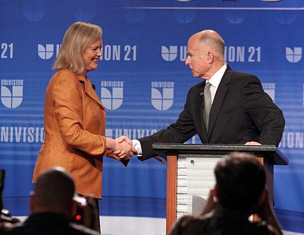 "California gubernatorial candidates Meg Whitman, left, and Jerry Brown shake hands at the start of their second debate at Fresno State Saturday, Oct. 2, 2010. Republican candidate Whitman is blaming her Democratic opponent  Brown, for the controversy overan illegal immigrant housekeeper. Early in their second debate Saturday, Whitman responded to a question about the flap by turning to Brown and saying he and his surrogates were to blame. Brown fired back, saying Whitman was evading responsibility: ""Don't run for governor if you can't stand up on your own two feet."" Photo: Eric Paul Zamora, AP"
