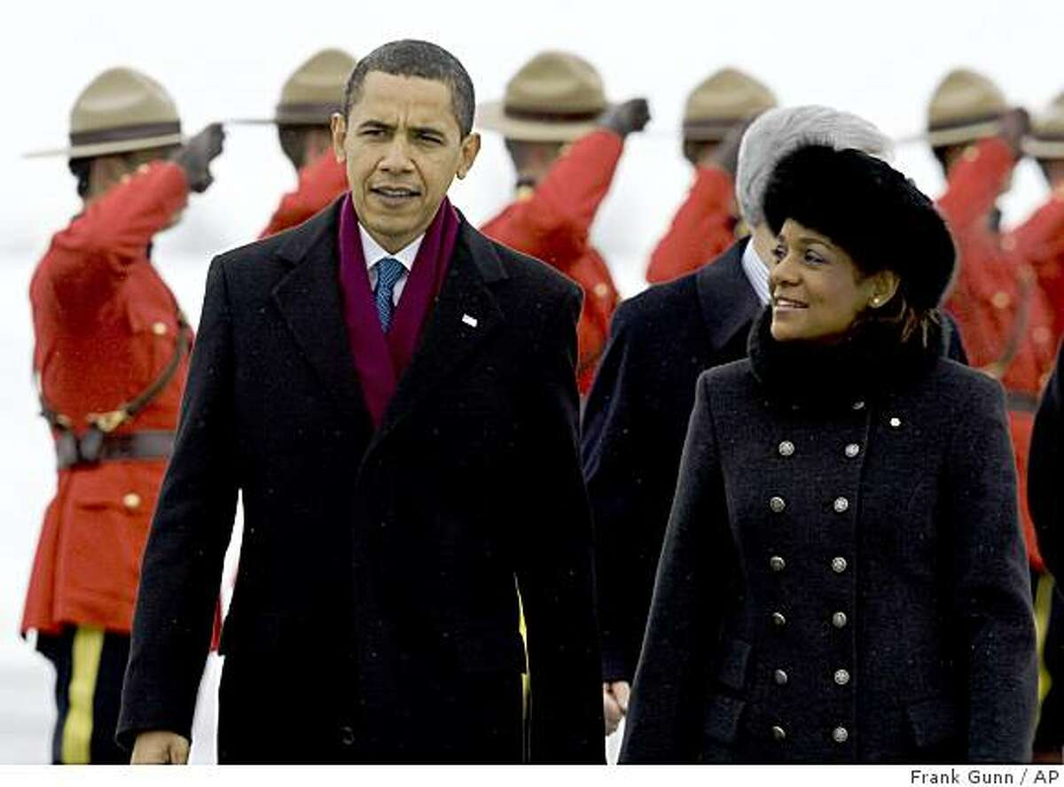 President Barack Obama and Canadian Governor General Michaelle Jean walk across the tarmac following his arrival in Ottawa, Canada, Thursday, Feb. 19, 2009. (AP Photo/The Canadian Press, Frank Gunn)