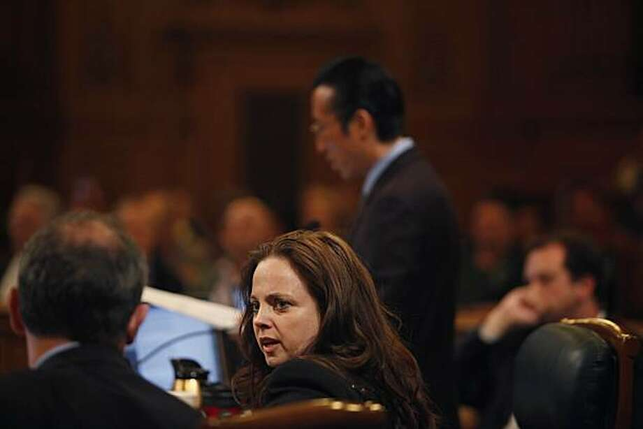 Supervisor Bevan Dufty (left) talks with Supervisor Michela Alioto-Pier  (second from left) as Supervisor Eric Mar (standing right) speaks during a San Francisco Board of Supervisors meeting at City Hall in San Francisco, Calif. on Tuesday May 4, 2010. Photo: Lea Suzuki, The Chronicle