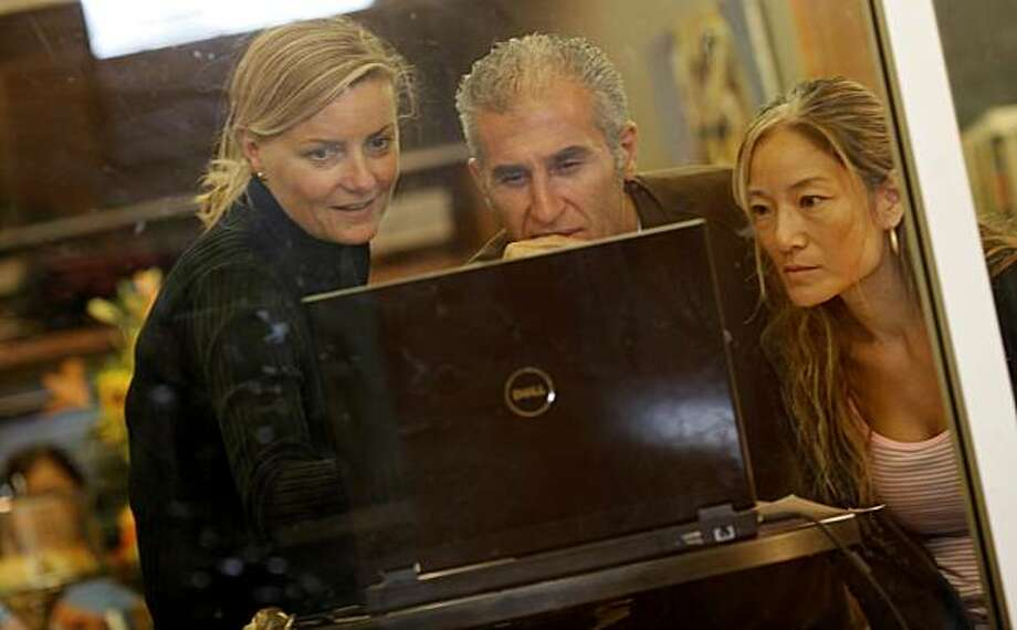 At the Jazzcaffe, which is in the building, Kristine Seinsch (left), Reza Ghaemi, and Nana Kim look over some pictures on a computer Tuesday, September 21, 2010. The Jazz School in Berkeley, Calif., was formed nine years ago and offers classes to budding jazz performers of all ages. Photo: Brant Ward, The Chronicle