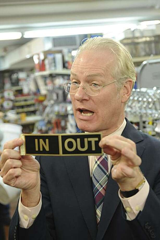 """Tim Gunn finds an appropriate sign during the """"Hard Wear"""" store challenge on Episode 7. Photo: Kannie Yu LaPack, Lifetime"""