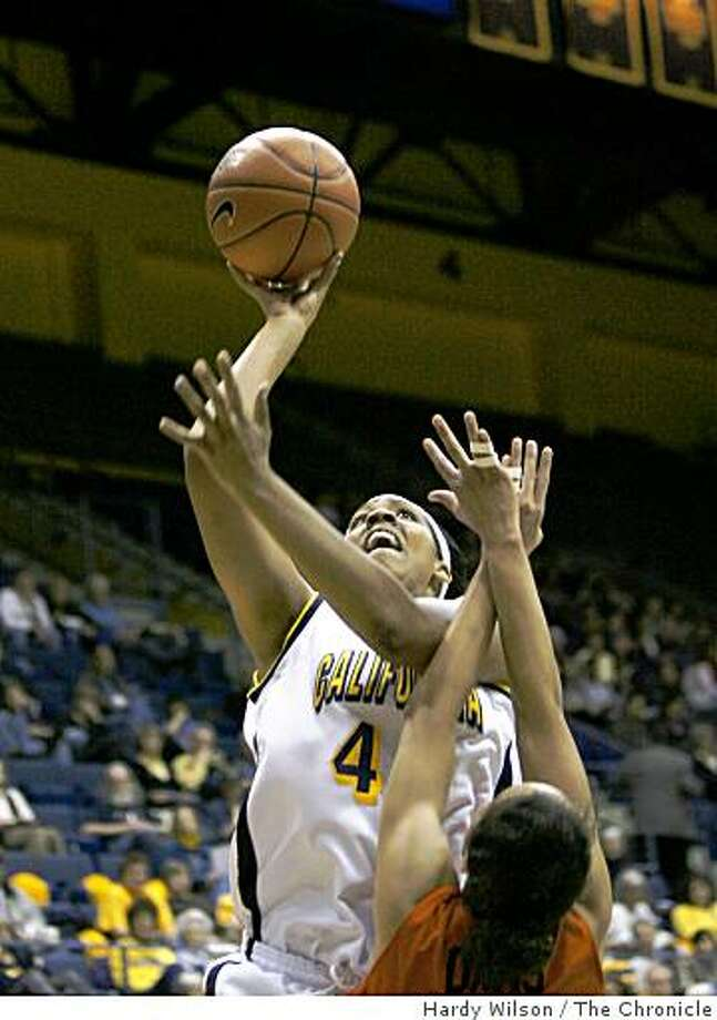 Cal Bears forward Ashley Walker (44), left, goes up for a shot in the first half against Oregon State Beavers guard Brittney Davis (20) on Saturday, February 21, 2009, at Haas Pavilion in Berkeley, Calif. Cal led Oregon State at the half 35-15. Photo: Hardy Wilson, The Chronicle
