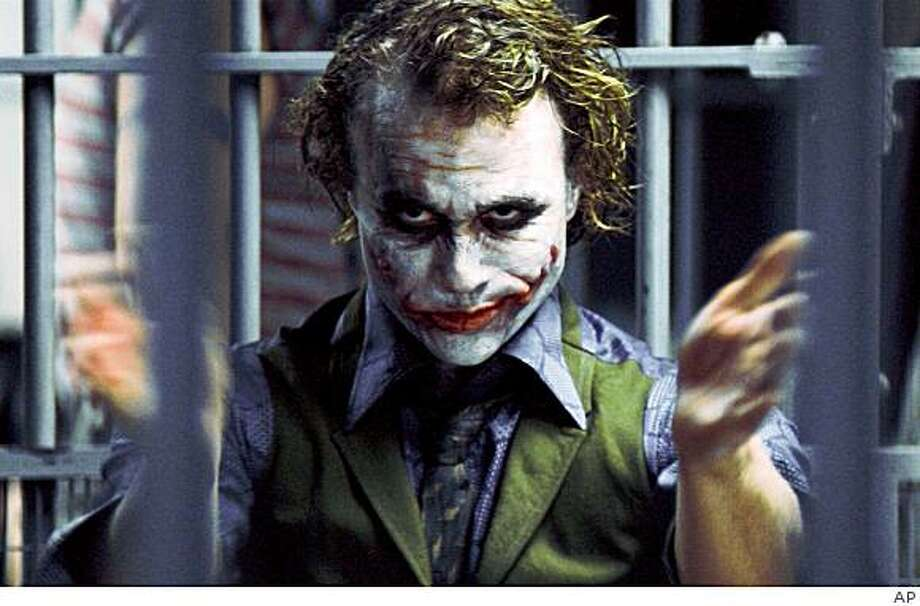 "In this image released by Warner Bros., Heath Ledger starring as The Joker, is shown in a scene from ""The Dark Knight.""   (AP Photo/Warner Bros. Pictures, Stephen Vaughan) ** NO SALES ** Photo: AP"