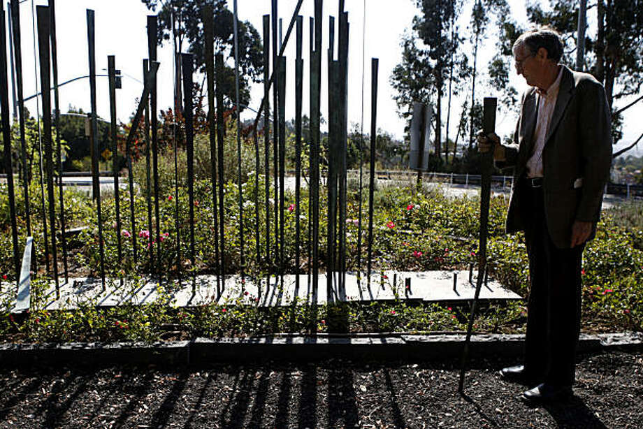 Gordon Piper, founder and chair of the Oakland Landscape Committee, stands next to the vandalized memorial sculpture at the Firestorm Memorial Garden in Oakland, Calif. on Sept. 07, 2010.   The bronze sculpture was created in 1993 to honor the 25 people who lost their homes and lives in the 1991 Oakland hills fire. Photo: Michelle Gachet, The Chronicle