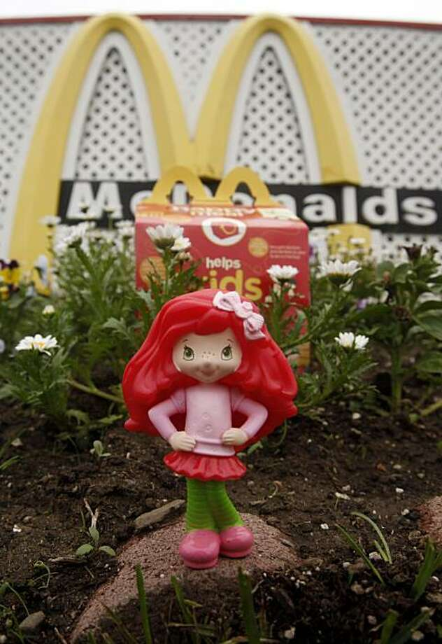 A Happy Meal box and toy are shown outside of a McDonald's restaurant in San Francisco, Friday, Oct. 1, 2010. A proposed city ordinance would require the giant hamburger chain to either stop putting little toys for kids in those Happy Meal boxes, or otherwise make them healthier by adding fruit and vegetable portions and limiting calories. Photo: Jeff Chiu, AP
