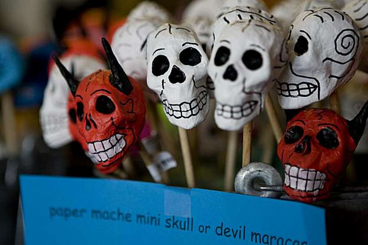 At Casa Bonampak, a Mexican folk arts store in the Mission, owner Nancy Charraga sells crafts such as these paper mache skulls used to celebrate Day of the Dead in San Francisco, Calif., on Thursday, October 8, 2009. Charraga got help to improve her business through the Women's Initiative for Self Employment.