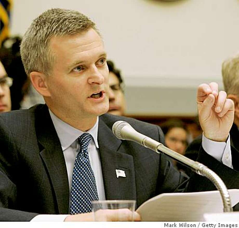 WASHINGTON - JULY 12:  Steven Bradbury (L), Acting Assistant Attorney General, Office of Legal Counsel for the Justice Department testifies while Daniel Dell'Orto (R) Principal Deputy General Counsel of Defense Department sits nearby during a House Armed Services Committee on Capitol Hill July 12, 2006 in Washington, DC. The committee is hearing testimomny on the standards of military commissions and tribunals for detainee's being held at Guantanamo Bay.  (Photo by Mark Wilson/Getty Images) Photo: Mark Wilson, Getty Images
