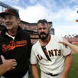 Giants manager Bruce Bochy and closer Brian Wilson celebrate a 3-0 win over the San Diego Padres and the NL West title at AT&T Park on Sunday.