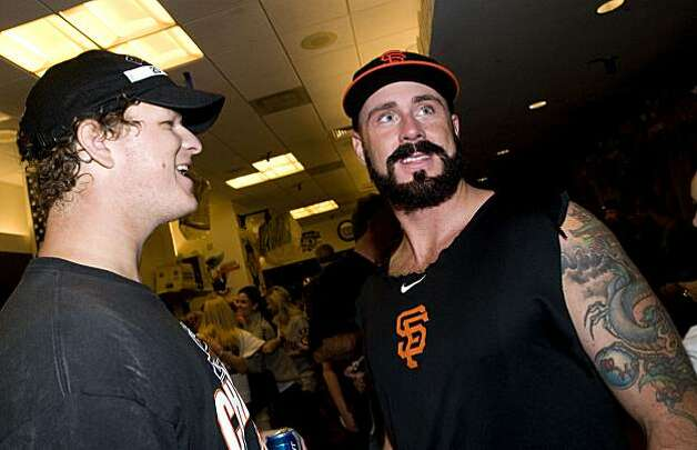 Matt Cain (left) and Brian Wilson share congratulations as the San Francisco Giants celebrate their National League West Championship after defeating the San Diego Padres at AT&T Park on Sunday. Photo: Chad Ziemendorf, The Chronicle