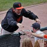 Giants coach Bruce Bochy greets fans after the big win Sunday in San Francisco.