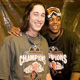 Tim Lincecum and Darren Ford share a laugh as the San Francisco Giants celebrate their National League West Championship after defeating the San Diego Padres at AT&T Park on Sunday.