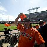 Jeff Severson turns around to get the crowd going during the third inning the San Francisco Giants take on the San Diego Padres at AT&T Park on Sunday.