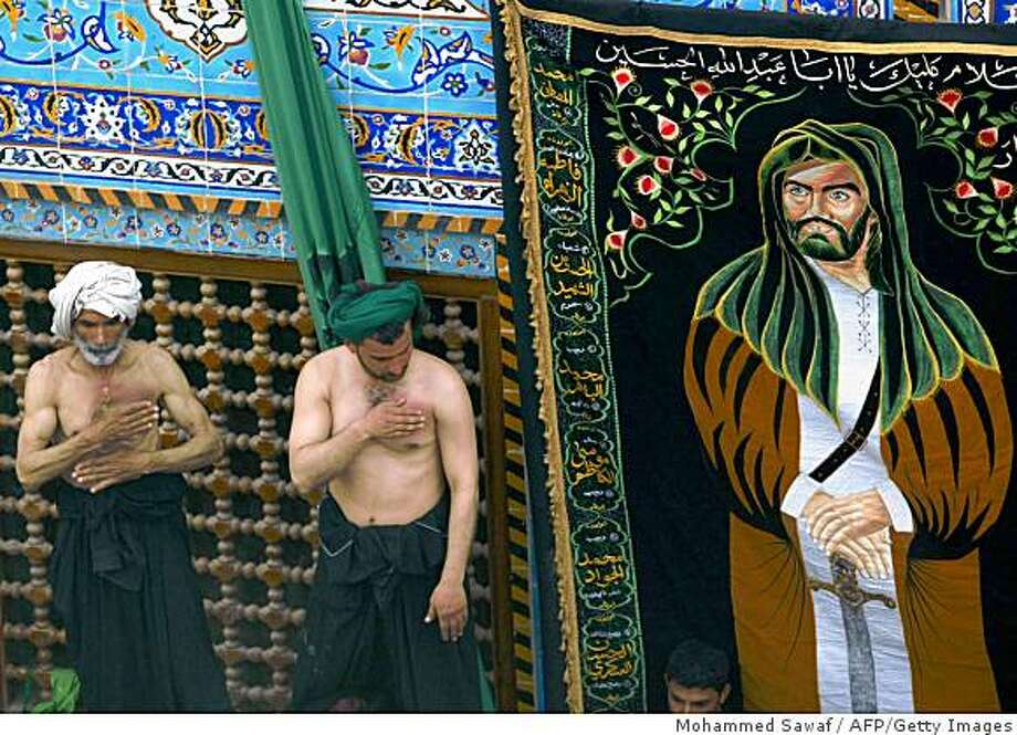 Shiite Muslim pilgrims beat their chests in the courtyard of the Imam Abbas shrine as they take part in the Aabaeen, 40 days of mourning after Ashura, in the holy central Iraqi city of Karbala, 120 kms from Baghdad on February 16 2009.  Arbaeen marks 40 days after the Ashura anniversary of the killing of Imam Hussein, the grandson of the Prophet Mohammed, by caliph Yazid's armies in AD 680, a key event leading to the Sunni-Shiite schism in Islam. Imam Abbas also died in this battle.  AFP PHOTO / MOHAMMED SAWAF  (Photo credit should read MOHAMMED SAWAF/AFP/Getty Images) Photo: Mohammed Sawaf, AFP/Getty Images