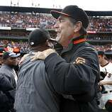 Manager Bruce Bochy celebrates the Giants' 3-0 win over the San Diego Padres and the NL West title with teammates at AT&T Park in San Francisco on Sunday.