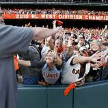 Pat Burrell is a hit with the fans after the Giants victory over the Padres on Sunday.