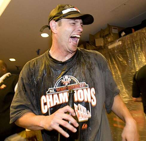 Freddy Sanchez laughs as he gets doused with beer as the San Francisco Giants celebrate their National League West Championship after defeating the San Diego Padres at AT&T Park on Sunday. Photo: Chad Ziemendorf, The Chronicle