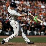 Buster Posey connects for his home run in the eighth inning Sunday.