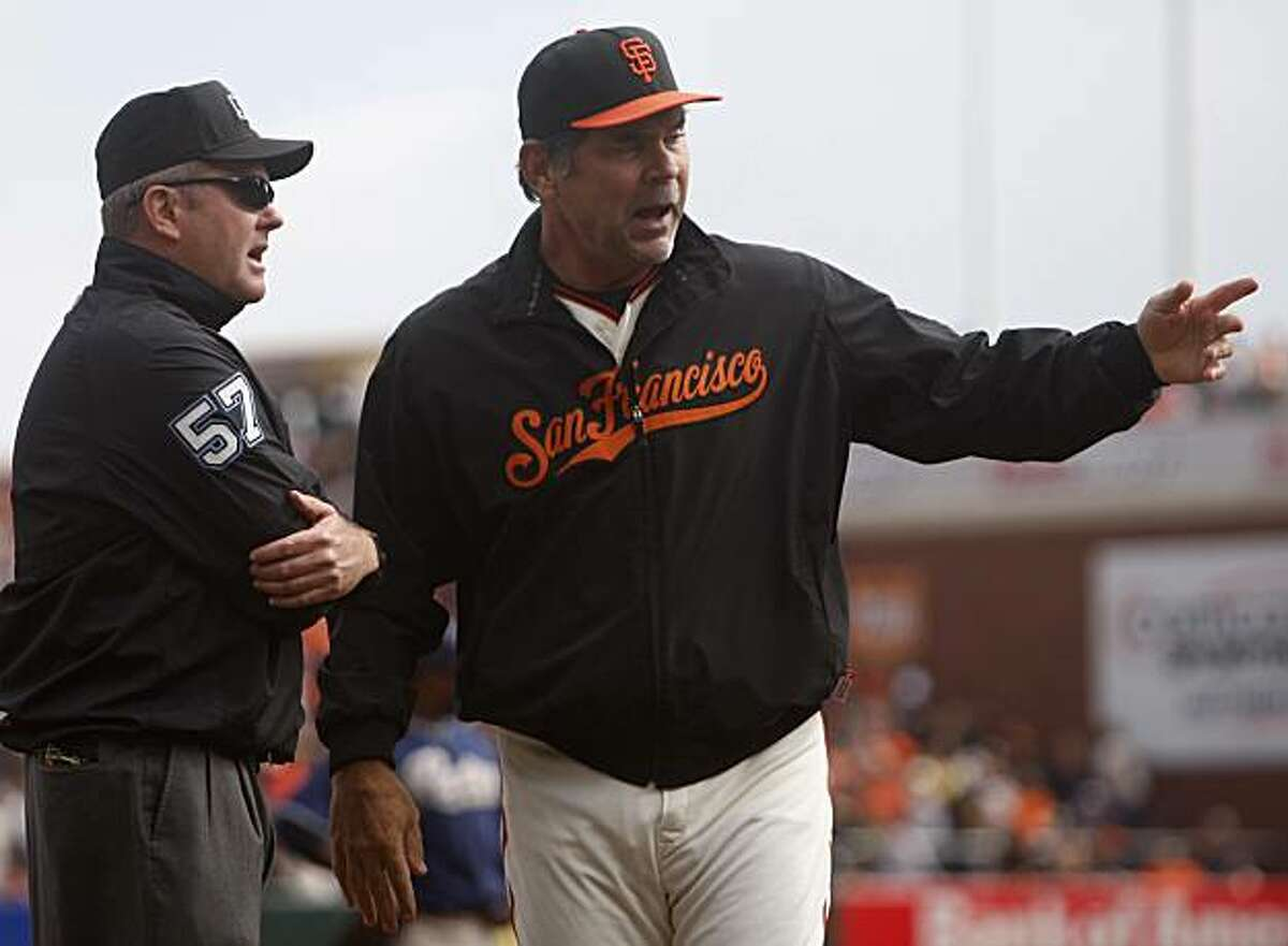 Manager Bruce Bochy has words with umpire Mike Everitt after Everitt called Andres Torres' drive down the third base line foul in the first inning of the San Francisco Giants game against the San Diego Padres at AT&T Park on Sunday.