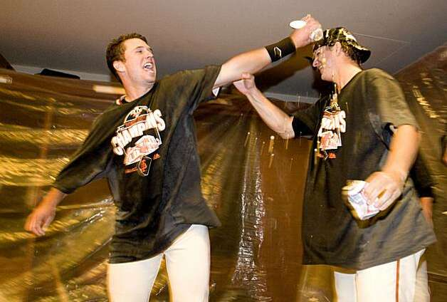 Buster Posey and Matt Cain shower each other with beer as the San Francisco Giants celebrate their  National League West Championship after defeating the San Diego Padres at AT&T Park on Sunday. Photo: Chad Ziemendorf, The Chronicle