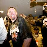 Aubrey Huff is showered with beer as the Giants celebrate their division championship after defeating the San Diego Padres at AT&T Park on Sunday.