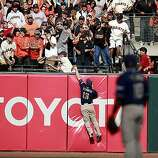 Chris Denorfia of the Padres can't reach Buster Posey's home run in the eighth inning Sunday.